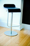 Modern barstool with gas-lift system. Black leather look designer metal gas lift style kitchen chair drink luxury cool floor Royalty Free Stock Photography