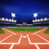 Modern baseball stadium with fans and green grass Stock Photo