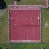 Modern basketball court in the courtyard on the centre of municipal sports and recreation. View of bird`s fly or drone. Modern bas royalty free stock images