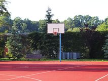 Modern basketball court in the courtyard of primary school. Multifunctional children`s playground with artificial surfaced fenced royalty free stock photo