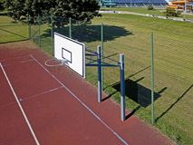 Modern basketball court in the courtyard of primary school. Multifunctional children`s playground with artificial surfaced fenced royalty free stock photography