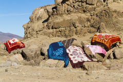 Modern Basotho Blankets Drying. LERIBE, LESOTHO - AUGUST 10, 2016: Modern Basotho blankets dry in the sun after being washed on a winter afternoon in rural stock photography