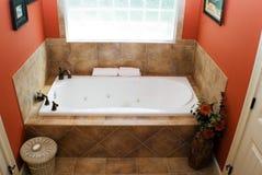 Modern Bath. A tub area of a colorful modern bath royalty free stock photo