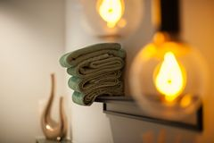 Bath interior with towels and lamp stock image