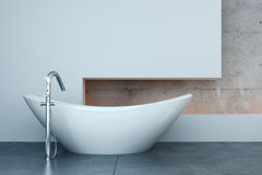 Modern bath tub in front of white wall. A 3d rendering of modern bath tub in front of white wall Stock Image