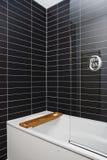 Modern bathroom. Detail white white appliances and gray ceramic tiles Stock Photography