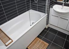 Modern bathroom. Detail white white appliances and gray ceramic tiles Royalty Free Stock Photos