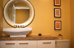 Modern Bathroom. New vanity, sink and round mirror in renovated bathroom Stock Photo