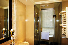 Modern bathroom. A modern grey bathroom, including shower, basins and toilet Royalty Free Stock Photo