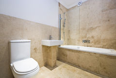 Modern bathroom. With natural stone tiles Royalty Free Stock Photo