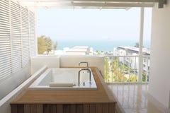 Modern bathroom. Luxury modern bathroom overlooking the sea Royalty Free Stock Photo
