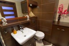 Modern bathroom. Modern brown bathroom interior with brown tiles Stock Photo