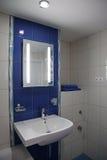 Modern bathroom. Modern small bathroom in flat stock photo