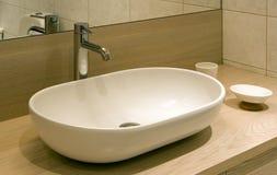 Modern bathroom. Close-up of the modern bathroom sink Royalty Free Stock Photo
