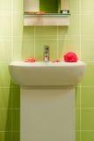 Modern bathroom. Green modern bathroom in a house Royalty Free Stock Photography