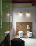 Modern bathroom in the attic room Royalty Free Stock Photos
