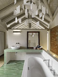 Modern bathroom in the attic. With wood ceiling and brick wall stock images