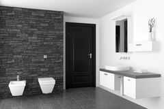 Modern bathroom with black stone wall