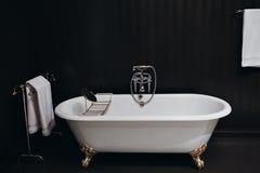 Modern bathroom with black tiles Royalty Free Stock Image