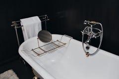 Modern bathroom with black tiles Stock Photo
