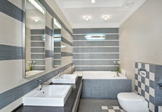 Modern bathroom in blue and gray tones with mosaic. On wide angle view Royalty Free Stock Images