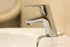 Modern bathroom chrome faucet Royalty Free Stock Image