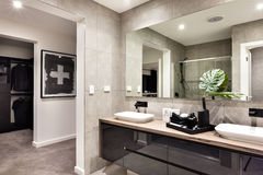 Modern bathroom closeup to a mirror and countertop Royalty Free Stock Photo