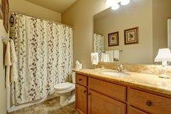 Modern bathroom with decorative shower curtain. Stock Photo