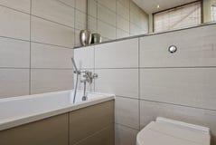 Modern bathroom detail. Detail of a modern bathroom with white ceramic appliances Royalty Free Stock Photo
