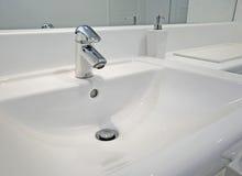 Modern bathroom detail. Luxury modern bathroom detail with designer water mixer tap Stock Images