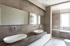 Modern bathroom with double sink. Bathroom sanitary ware suspended royalty free stock image