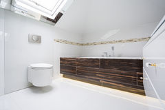 Modern bathroom. Modern estate white bathroom with wooden units stock image
