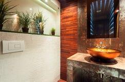 Modern bathroom in expensive house Stock Photos