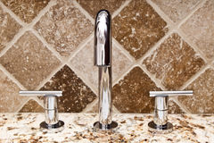 Modern bathroom faucet Stock Images