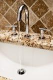 Modern bathroom faucet Stock Photography