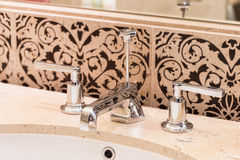 Modern bathroom faucet Royalty Free Stock Images
