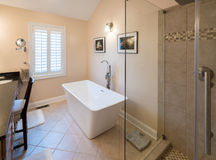 Modern bathroom with freestanding tub and shower Royalty Free Stock Photo