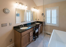 Modern bathroom with freestanding tub and vanity Stock Images