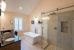 Modern bathroom with freestanding tub and vanity Royalty Free Stock Images