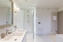 Modern bathroom with glass shower cubicle Royalty Free Stock Photos