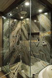 Modern bathroom with green granite walls. Royalty Free Stock Photos