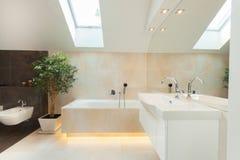Modern bathroom with illuminated bathtube. Beautiful modern bathroom with big illuminated bathtube stock photography