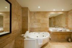 Modern Bathroom interior. With marble tiles and mirror Stock Photos