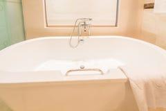 Modern bathroom interior with bathtub Stock Images