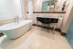 Modern bathroom interior with bathtub Stock Photos