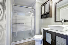 Modern bathroom interior with brown cabinets Stock Photo