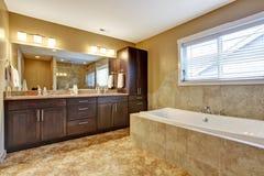 Modern bathroom interior with dark brown cabinets Stock Image