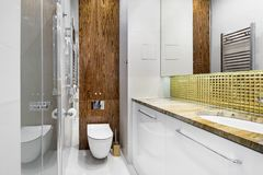 Modern bathroom interior design. In wooden and white finish Royalty Free Stock Photo