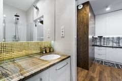 Modern bathroom interior design. In wooden and white finish Stock Photos