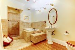 Modern bathroom interior with hardwood floor, white sink, tub wi Stock Photography